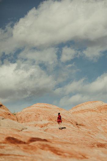 Man skiing in desert against sky