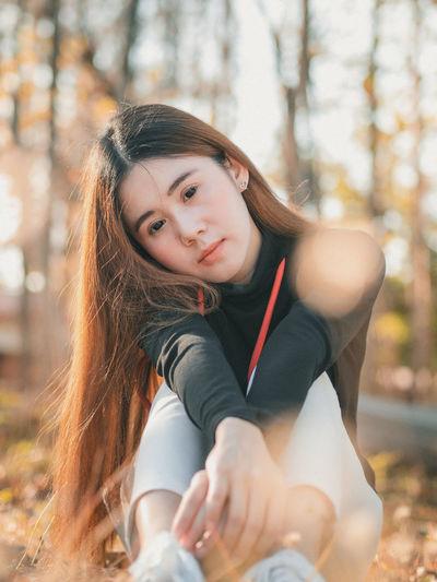 Portrait of women sitting outdoors