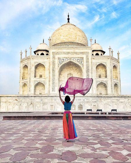 Rear view of woman walking in temple