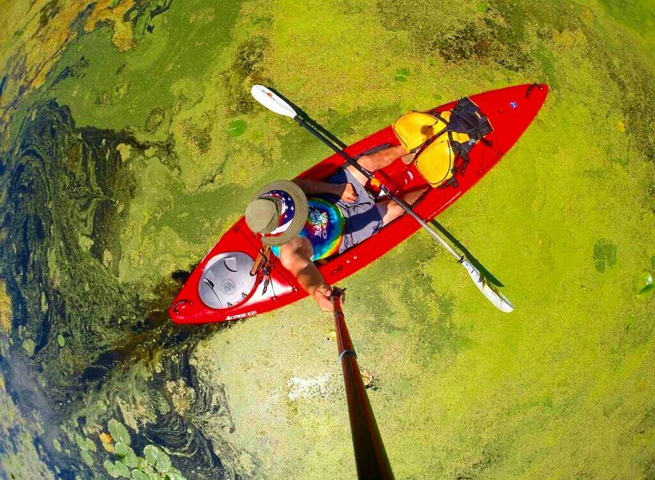 Directly above shot of man kayaking in lake
