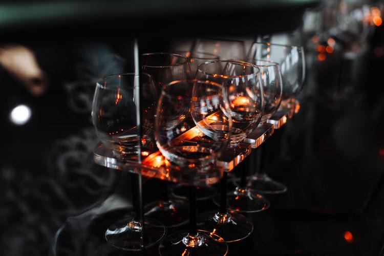 Close-up of wine glasses in darkroom