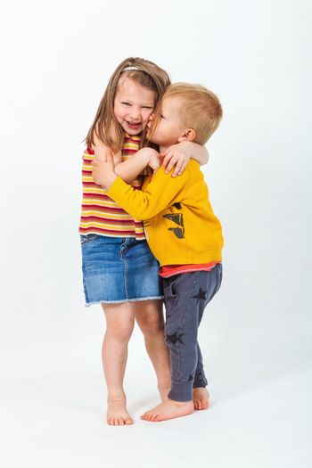 Brothers in Love Studio Shot Kiss Smile Hug Hugs Cheerful Happy Smile Smiling Relations Brothers Sister Childhood Child Young Friendship Child Full Length Childhood Bonding Togetherness White Background Females Smiling Girls Family Bonds Offspring Brother Sister Family