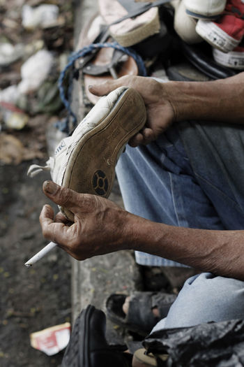 Low Section Of Shoemaker Holding Shoe