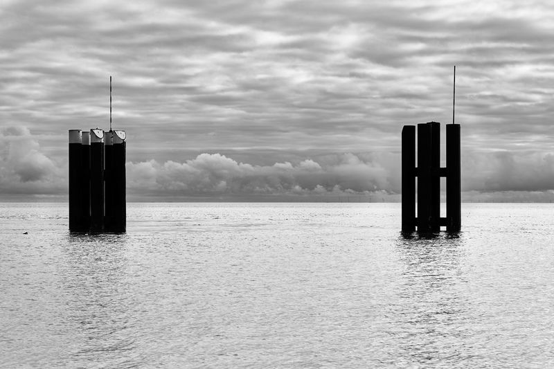 Cloud - Sky Water Sky Sea Waterfront Post Nature Day No People Outdoors Beauty In Nature Wooden Post Pole Architecture Scenics - Nature Horizon Over Water Tranquility Built Structure Tranquil Scene Sylt Sylt, Germany Sylt_collection Harbour