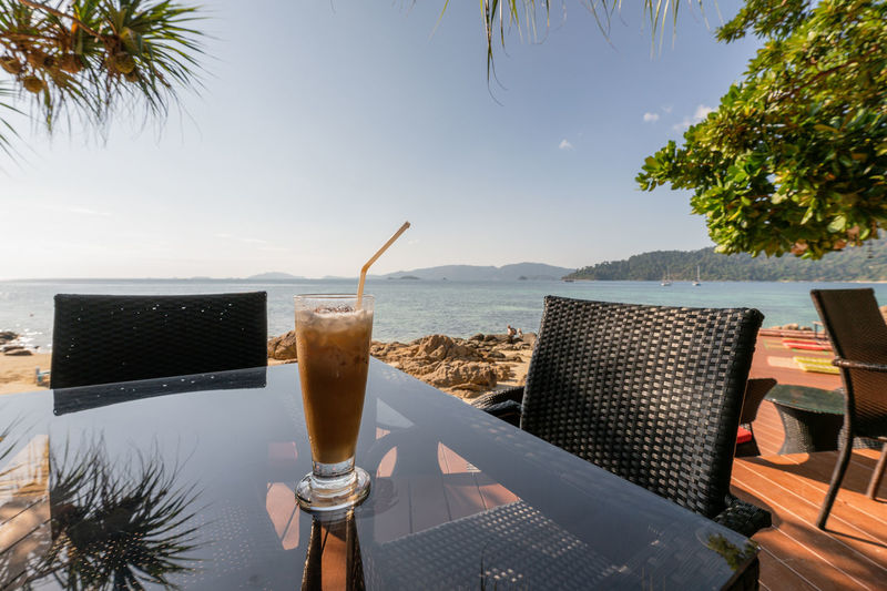 Background Beach Beautiful Beverage Blue Breakfast Bright Cafe Cappuccino Chair City Coffee Color Cup Decor Design Drink Espresso Glass Holiday Hot Idyllic Morning Mountain Mug Nature Nobody Ocean Park Reflection Relax Relaxation Relaxing Restaurant Sea Shine Sky Space Summer Sunny Table Travel Tree Tropical Vacation View Water White Wooden