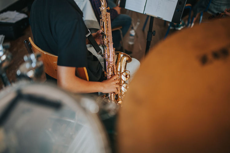 Learning Music Music Academy Saxophonist Artist Incidental People Lifestyles Music music brings us together Musical Equipment Musical Instrument Musician Occupation Outdoors Playing Real People Saxophone Standing