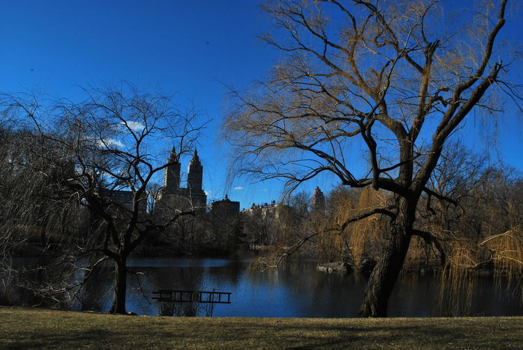 Lake In Central Park By The Eldorado Against Sky