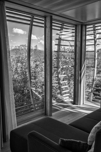 Amazing architecture with a breathtaking view EyeEm Best Shots Interior Design Nature Dolomites, Italy Home With A View B/W Photography Fincube Lobis Modern Architecture Wood - Material Wooden House View Curtain Window Looking Through Window Architecture Built Structure Sky Wooden The Architect - 2018 EyeEm Awards