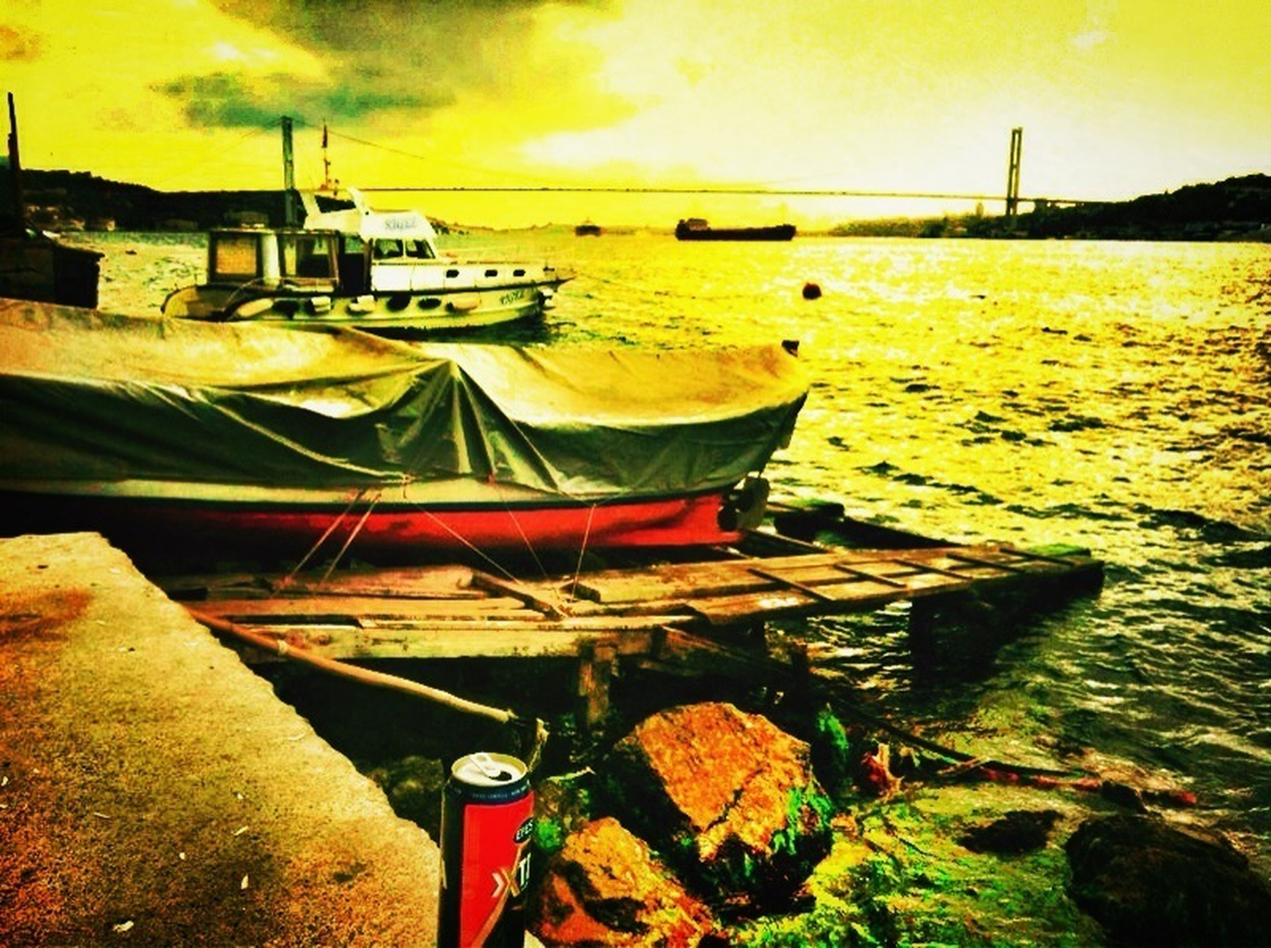 sunset, water, transportation, sky, nautical vessel, orange color, mode of transport, cloud - sky, sea, boat, moored, river, built structure, nature, beauty in nature, tranquility, yellow, architecture, scenics, harbor