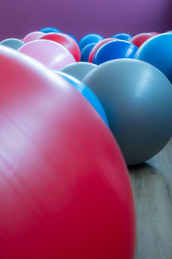 Many different colored exercise balls Exercise Balls Red Pink Color Blue No People Indoors  Multi Colored Close-up Ball Celebration Sphere Group Of Objects Sport Event In A Row Still Life Group Studio Shot Balloon Inflatable