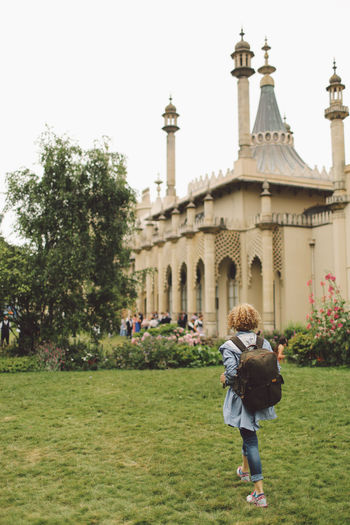 Arch Architecture Blonde Brighton Built Structure Casual Clothing Curly Hair Day Dome Façade Famous Place Girl Grass History International Landmark Lawn Leisure Activity Lifestyles Royal Pavilion Royal Pavilion Gardens Sky Tourism Tourist Travel Destinations Vacations An Eye For Travel