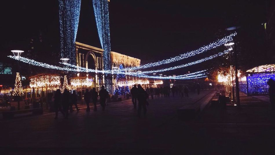 Holidays are here Christmas Night Lighting Equipment Christmas Decoration Celebration Illuminated Christmas Lights Large Group Of People Architecture Built Structure Christmas Market Christmas Tree City Vacations Event Real People People Sky Christmas Ornament Tree