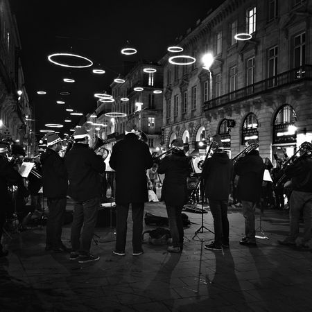Night Real People Street Men Group Of People City Standing Crowd Leisure Activity Women People Illuminated Outdoors Music Christmas Lights Bordeaux France Bnwphotography Monochrome Blackandwhite Streetphotography People And Places City Life