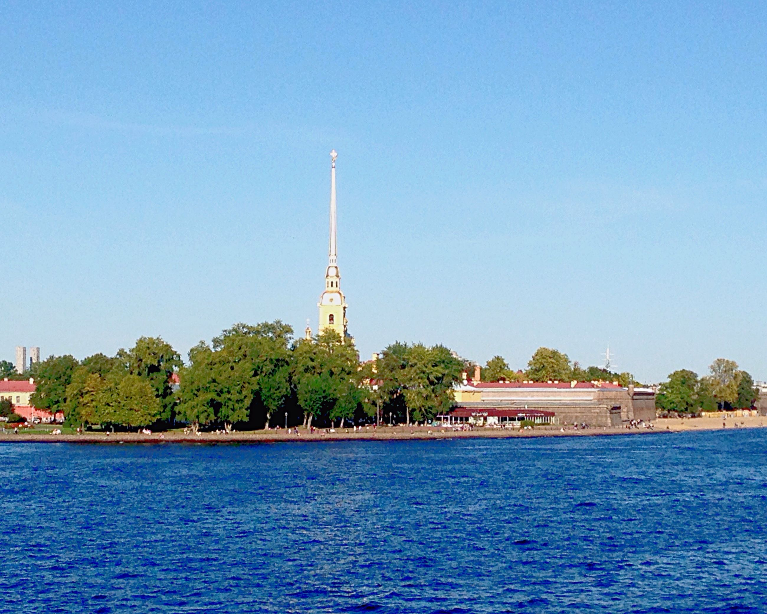 clear sky, water, blue, tree, waterfront, copy space, built structure, architecture, building exterior, travel, travel destinations, famous place, religion, tourism, tranquility, lake, day, nature, spirituality, sea