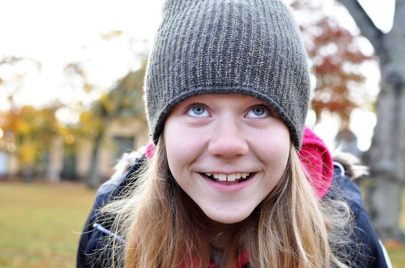 Smiling girl wearing knit hat