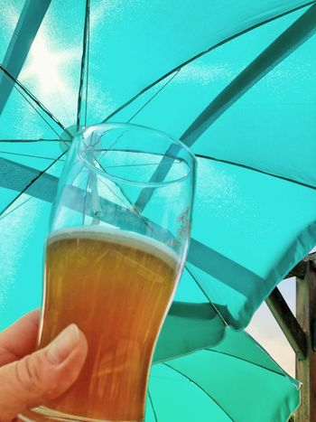 Summer Sun Parasol Beer Glass Beer Human Hand Refreshment Drink Human Body Part One Person Hand Alcohol Food And Drink Umbrella Holding Glass Day Close-up Real People Lifestyles Unrecognizable Person Finger Drinking