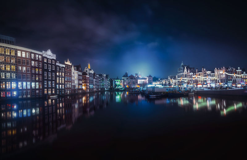 Amsterdam EyeEmNewHere Illuminated Night Water Reflection Building Exterior Architecture City Sky Built Structure Cloud - Sky Waterfront Nature No People Building River Outdoors Nautical Vessel City Life Cityscape EyeEm Best Shots EyeEm Selects