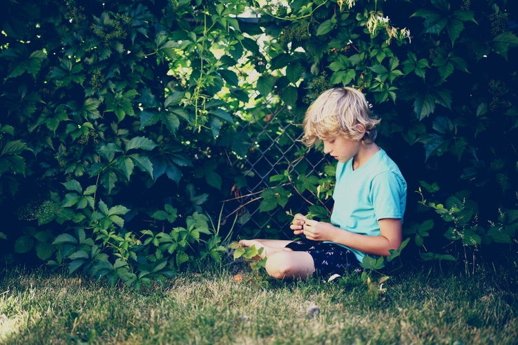 Beauty In Nature Blond Hair Childhood Day Grass Growth Nature One Person Outdoors People Plant Real People Sitting