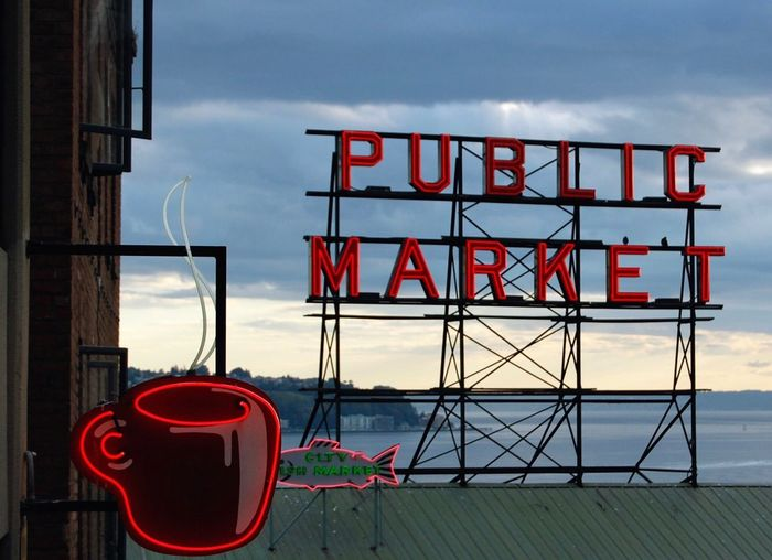 Sky Outdoors Text No People Built Structure Architecture Seattle Seattle Skyline Seattle Waterfront Seattle Fish Market
