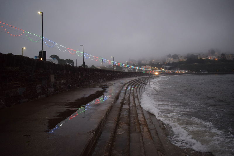 Coastline Colourful English Coastline Lights Reflection Beach Coast Dull But Beautiful England Evening Fog Illuminated Mist Night No People Ocean Outdoors Reflections Sea Sky Street Light Streetphotography Tide Water Waves
