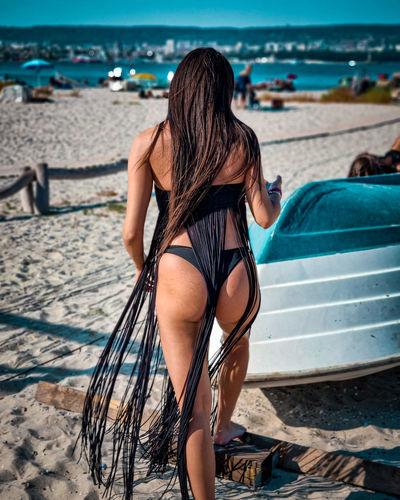 Rear view of woman in bikini on beach