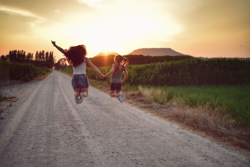 Summer Arms Raised Two People Human Arm Human Body Part Young Adult Fun Adult Sunset Togetherness Young Women People Rear View Cheerful Girls Happiness Women Outdoors Rural Scene Nature Sunset_collection Sunsets Funtimes Freedom! Life's Simple Pleasures...