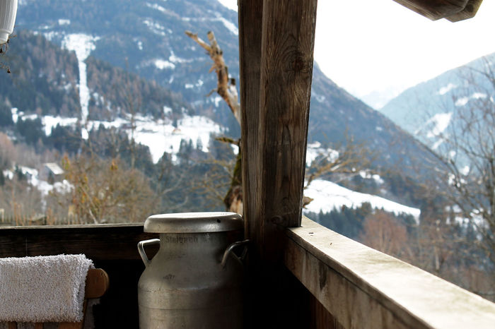 Alpine Impressions. Alpine Austria Vacations Balcony Beauty In Nature Can Close-up Cold Temperature Day Landscape Leisure Activity Lifestyles Milk Tea Mountain Mountain Range Nature No People Outdoors Sky Snow Tourism Travel Destinations Tree Winter Wood - Material