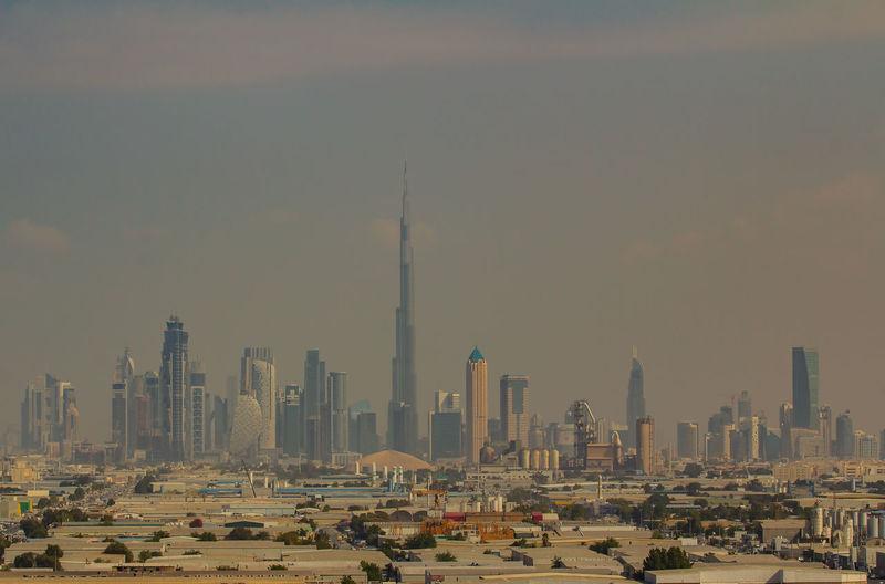 skyline of Dubai at the sandstorm Burj Khalifa Burj Al Arab Center Dubai Skyline Skyscraper United Arab Emirates Architecture Building Sandstorm Apartment Hotel Office Downtown High-Rise Tall Tower Floors Building Height Spire  Built Structure Observation Deck