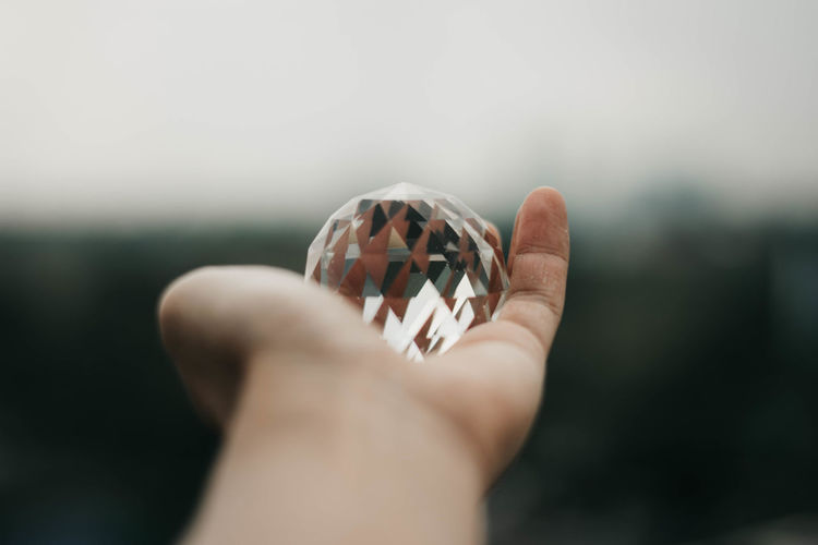 Close-up of hand holding crystal