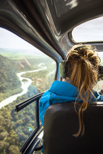 Rear View Of Woman In Helicopter