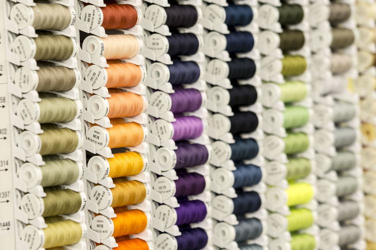 Full Frame Shot Of Colorful Spools On Rack
