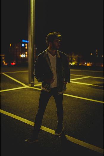 Full length of man looking at illuminated city