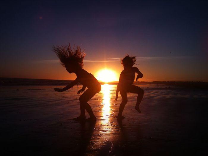 Girls dancing at sunset