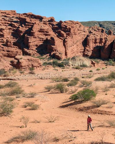 Full length of man on rock formations in desert