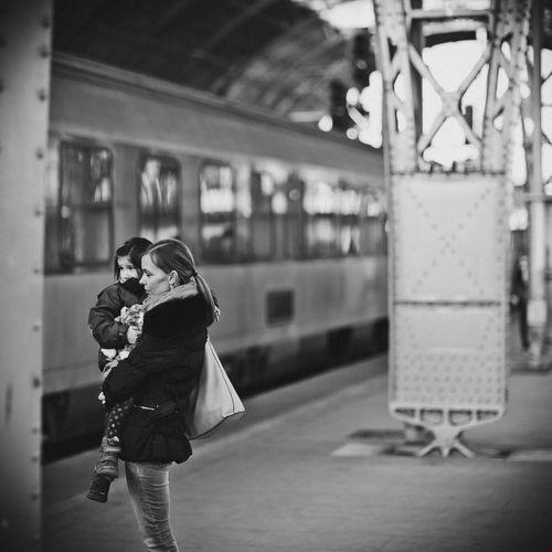 Woman Standing On Train Station Platform