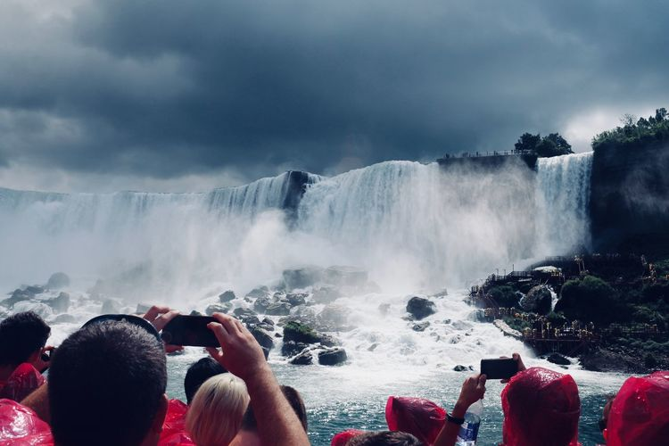 People photographing waterfall