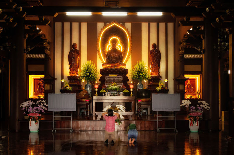 Praying in pagoda Vietnam Vietnamese Pagoda Vietnamese Praying Buddha Buddha Statue Buddha Temple Belief Faith God Religion Asian Religion Illuminated Water Tree Flame Tea Light Sculpture Place Of Worship Church