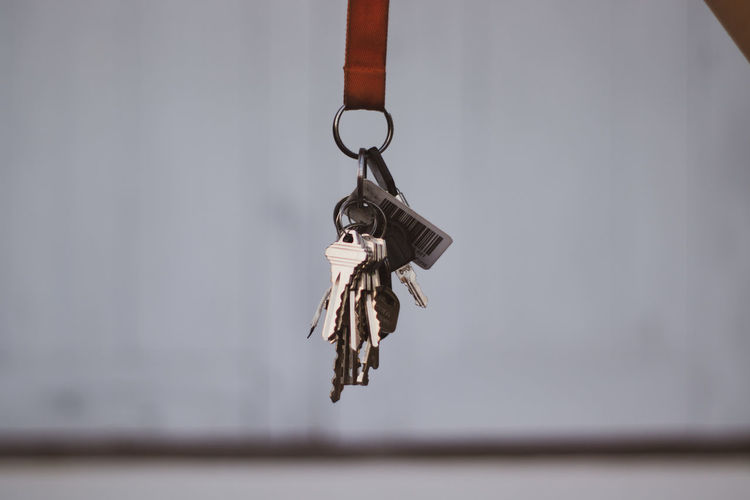 Close-up of key hanging against wall