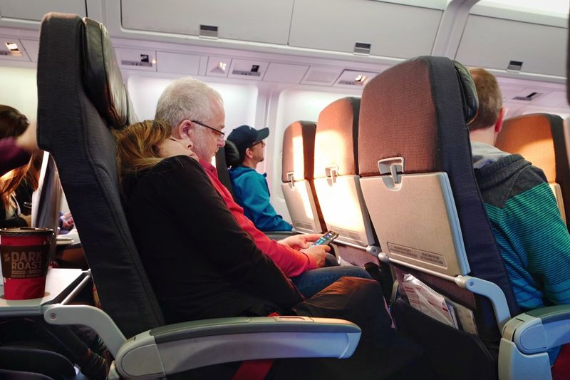 Sunlight Through The Window Sunlight Trip Lifestyles It's About The Journey Transportation Mode Of Transportation Airplane Air Vehicle Travel Adult Sitting Seat Senior Adult Journey Flying Technology Passenger Passenger Cabin Airplane Seat