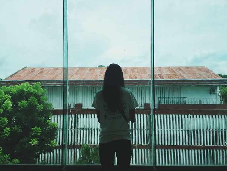 Rear View Standing Transparent Railing Glass - Material Sky Architecture Three Quarter Length Window Person Balcony Casual Clothing Day Cloud Contemplation Mountain Filipina Eyeem Philippines EyeEm EyeEm Best Shots Lights And Shadows Light And Shadow Philippines