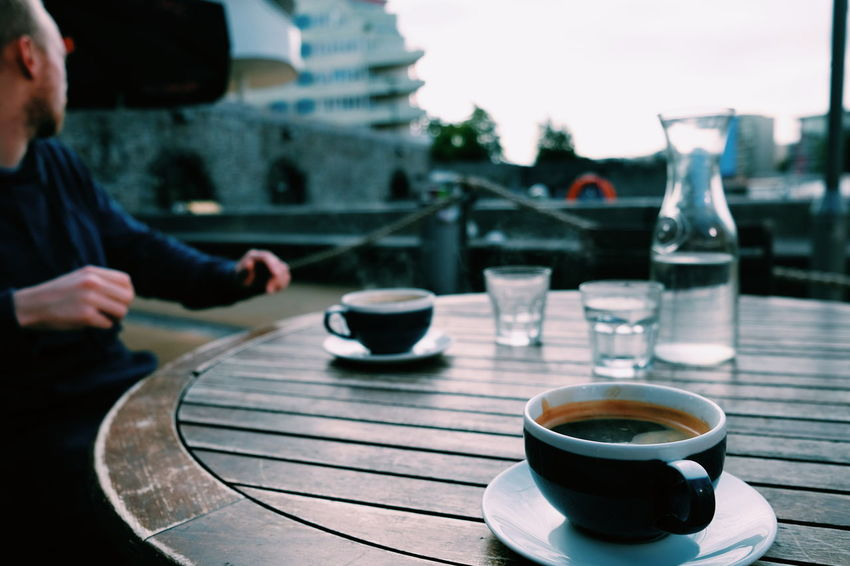 Food And Drink Coffee Cup Coffee - Drink Drink Refreshment Table Real People Cup Focus On Foreground One Person Saucer Day Outdoors Sitting Human Hand Close-up Freshness Food Breakfast FUJIFILM X-T10 XF18-55mmF2.8-4 R LM OIS F/3.2 Iso 200 via Fotofall