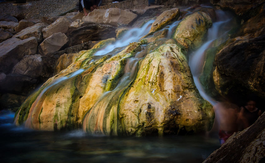 Adult Adults Only Beauty In Nature Day Environmental Conservation Igniting Nature One Person Outdoors People Refraction River Rock - Object Scenics Social Issues Stream - Flowing Water Summer Travel Destinations Vacations Water Waterfall
