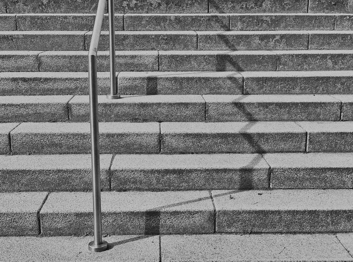 High angle view of shadow on staircase in city