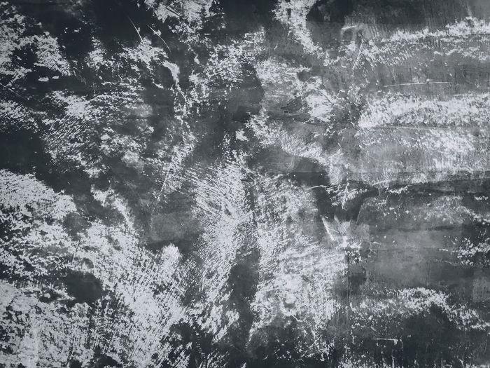 Full frame shot of water flowing through rocks