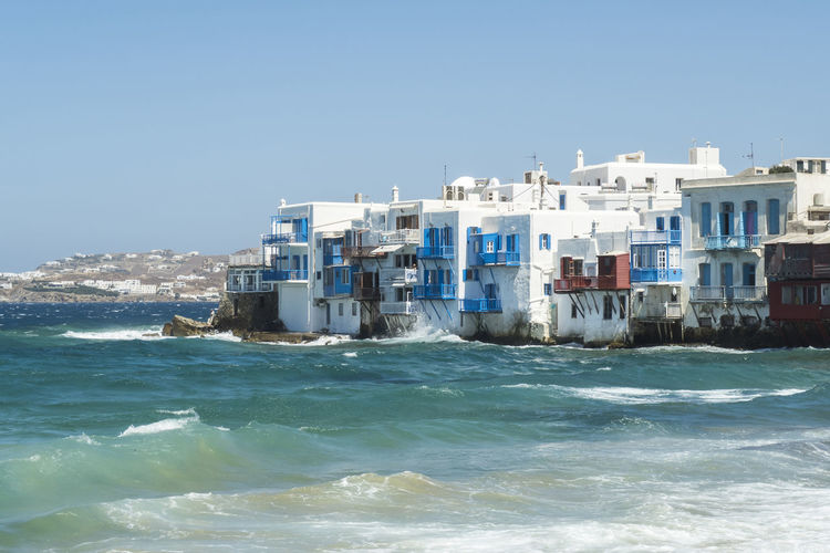 Mykonos, Greece - August 14 2016: Aleykantra's traditional white houses. Small Venice starts from Alefkantra beach and stretches up to the Castle area. Aegean Aleykantra Aleykantra Mykonos Architecture Architecture Bay Area Beauty In Nature Blue Coastline Cruise Cyclades Greece Greek Islands Landscape Little Venice Mykonos Mediterranean  Mykonos Mykonos Greece Mykonos Island Mykonos Town Scenics Sea Small Venice Mykonos Travel Waterfront