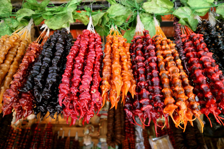 Close-up of fruits hanging in market stall