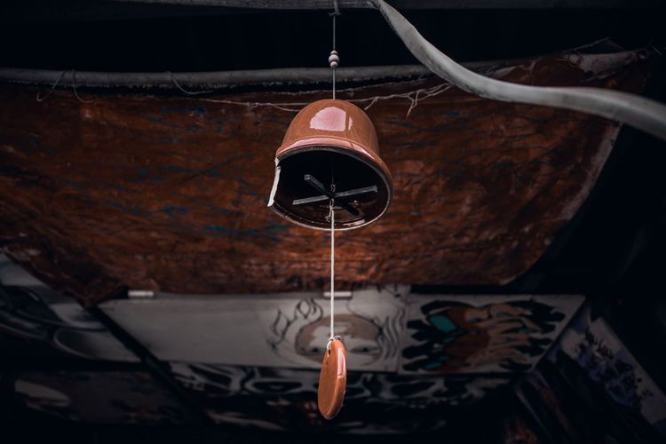 Low Angle View Of Abandoned Bell Hanging From Ceiling