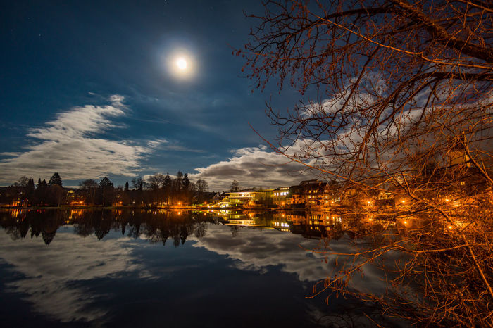 The lake in Bad Waldsee at a fullmoon night. Bad Waldsee Bare Tree Beauty In Nature Cloud - Sky Full Moon Fullmoon Illuminated Lake Moon Moonlight Nature Night No People Outdoors Plant Reflection Scenics - Nature Sky Tranquil Scene Tranquility Tree Waldsee Water Waterfront