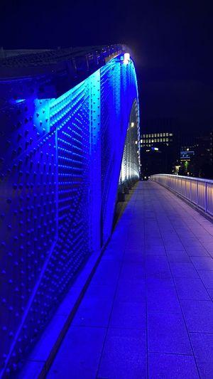 Illuminated lights on bridge at night