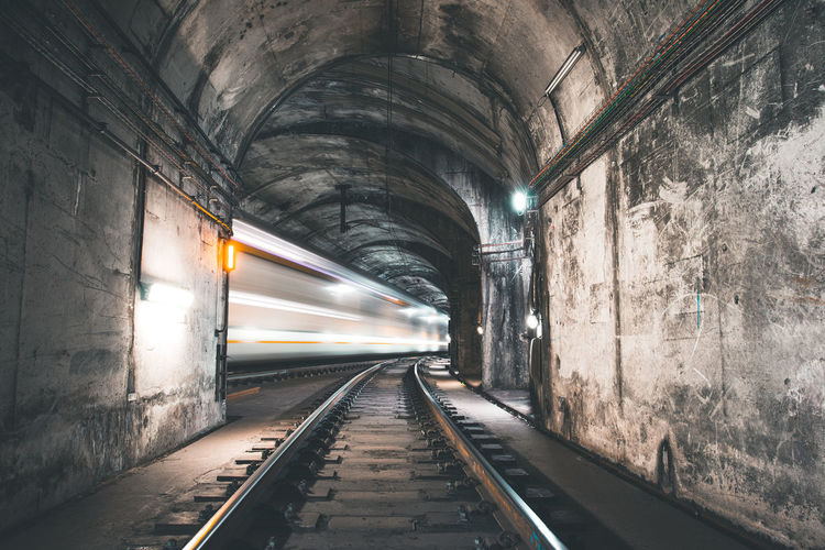 Long Exposure Image Of Railroad Tracks In Tunnel